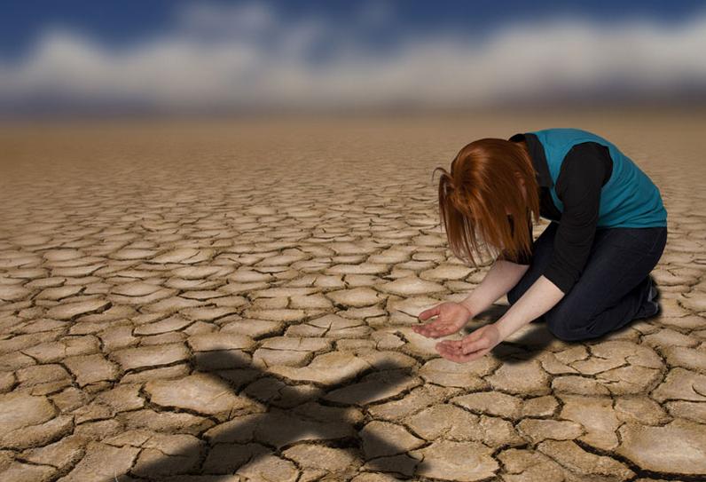 woman kneeling at cross
